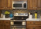 Black White Small Tiles Kitchen Backsplash Designs and Brown Wood Kitchen Cabinet Designs