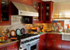 Metal Kitchen Backsplash Designs Ideas with Red Brown Wood Solid Kitchen Cabinet