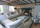 spanish cottage style living room furniture sets with wood beam ceiling design