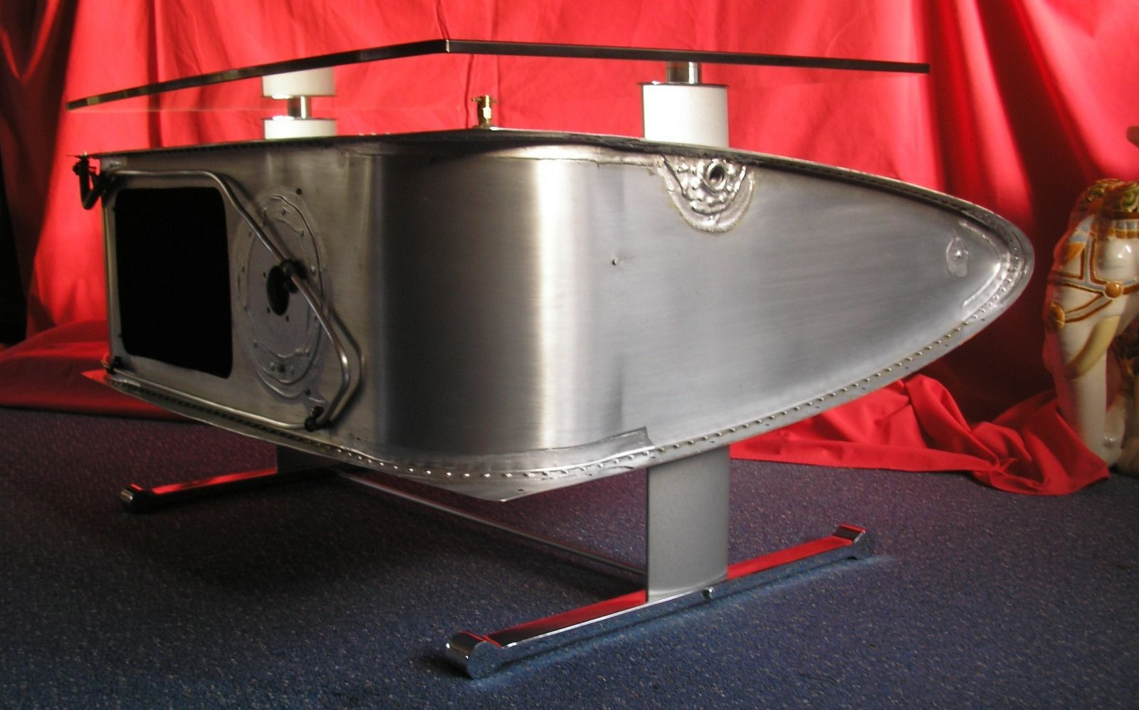 airplane wing coffee table with glass on top