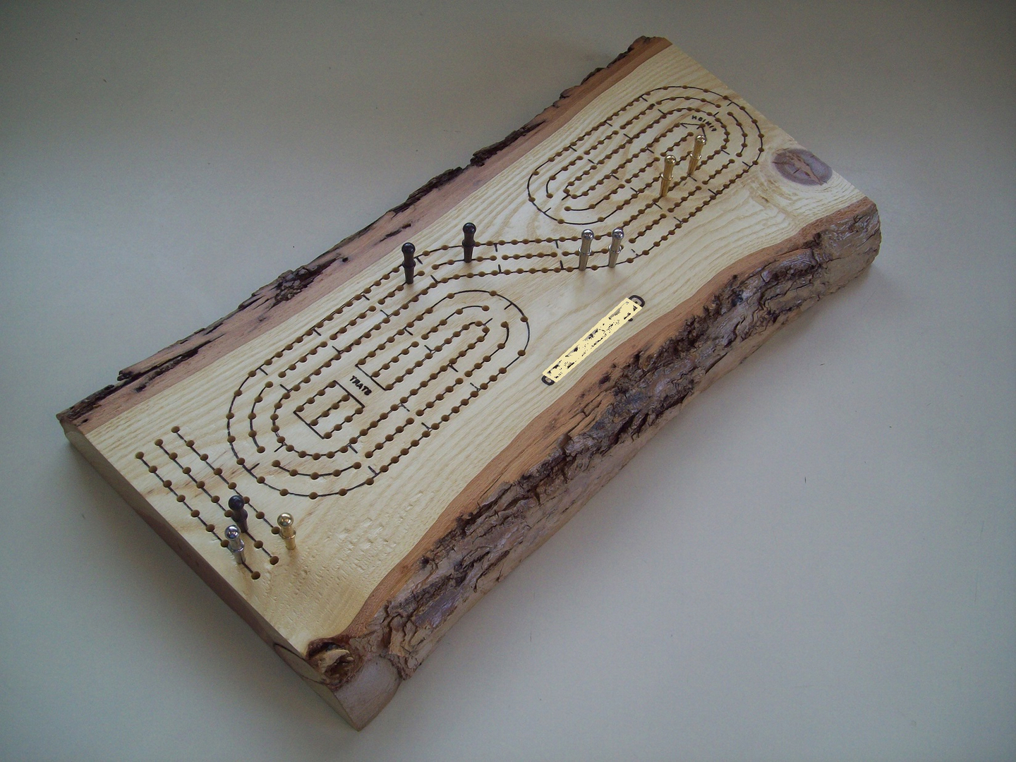 low wooden log cribbage board coffee table