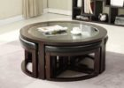 round coffee table with pull out ottomans with glass on top