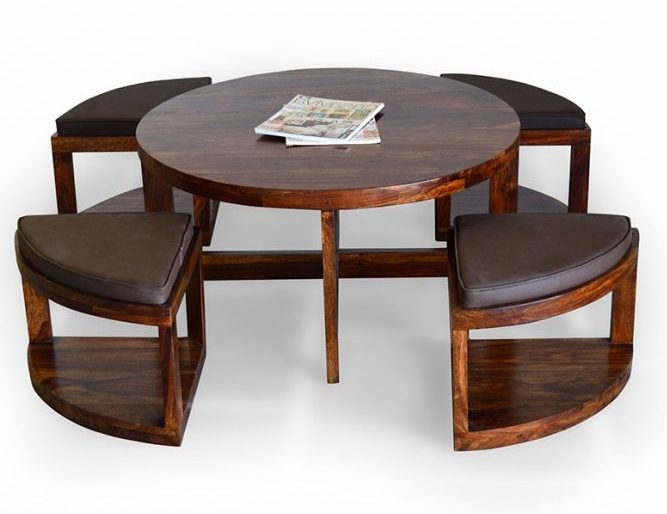round wooden coffee table with chairs underneath furniture