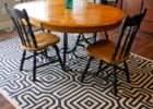 should you put area rug under dining table