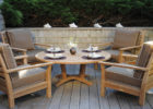 small wooden round coffee table with seats