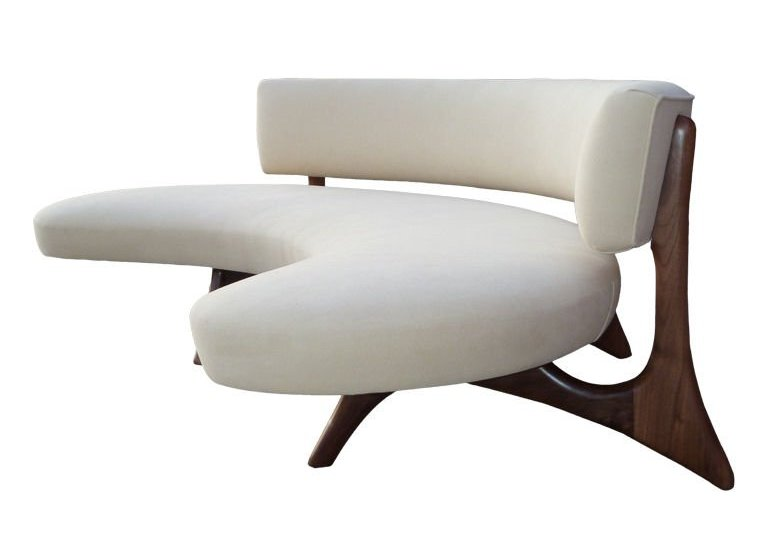 white curved settee for round dining table