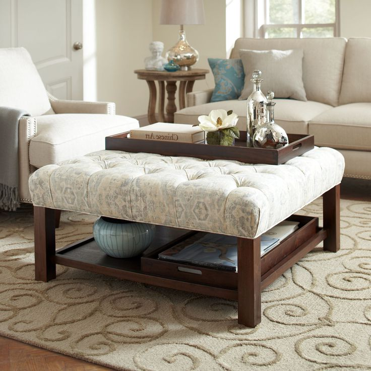 white fabric cushion coffee table with storage