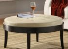 white leather ottoman coffee table with black wood legs