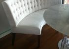 white tufted curved bench for round dining table