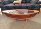 wood canoe coffee table glass top
