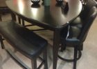 black triangle dining table with bench