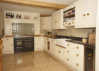 kitchen remodels with white cabinets black appliances
