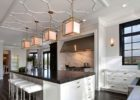 kitchen remodels with white cabinets black countertops