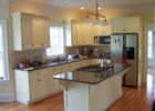 kitchen remodels with white cabinets black granite