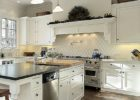 kitchen remodels with white cabinets dark floors