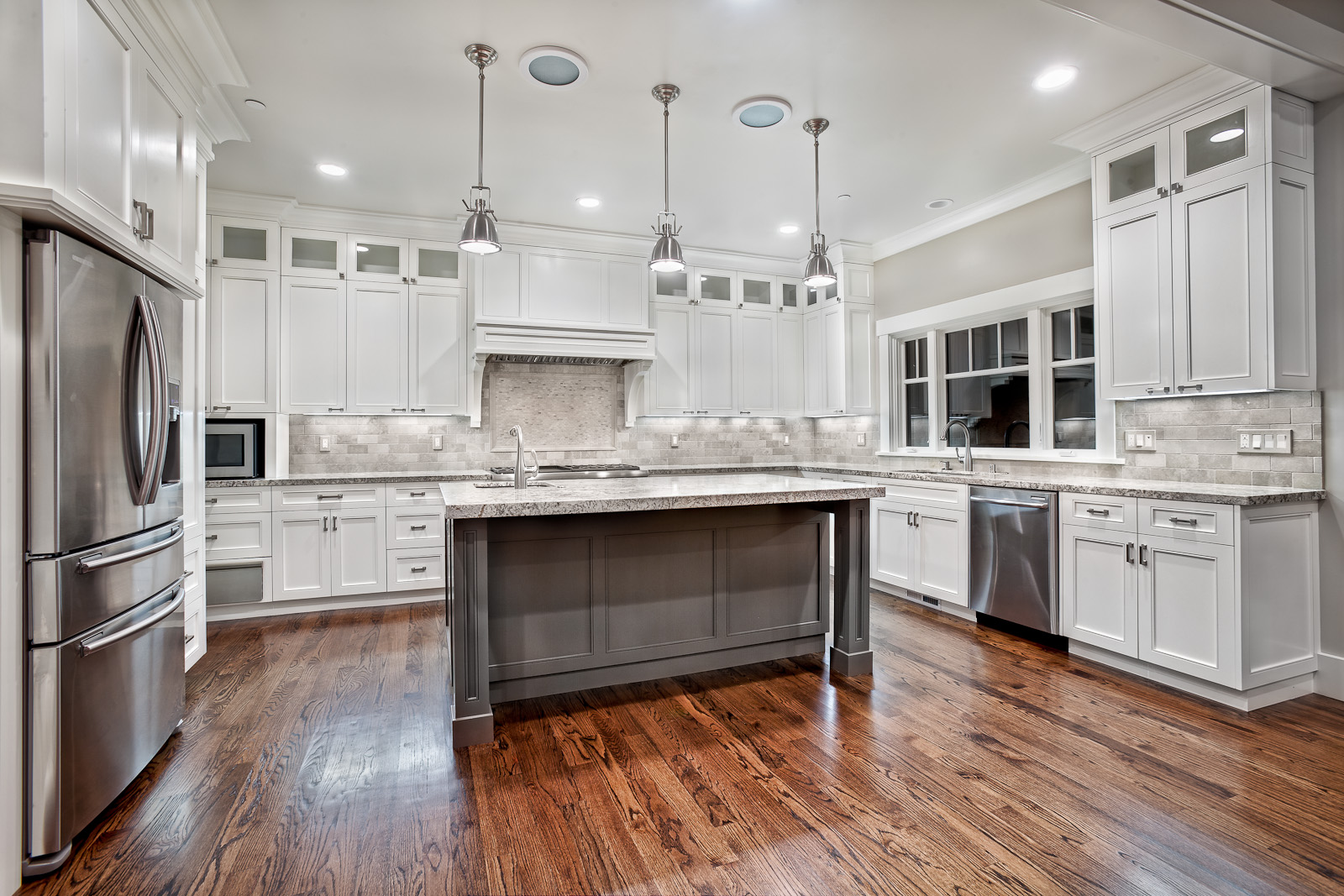 kitchen remodels with white cabinets dark island