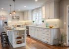 kitchen remodels with white cabinets wood floor and granite countertops