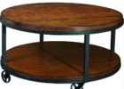 round distressed dark wood coffee table with wheels