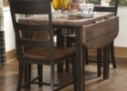 round espresso drop leaf dining table for small spaces