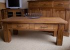 solid distressed dark wood coffee table with drawers