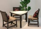 white triangle dining table with bench