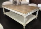 distressed white wood coffee table with storages
