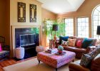 family room ideas Colorful Pillows on Brown Sofas inside Bohemian Decorating Ideas with Modern Fireplace facing Wide Ottoman