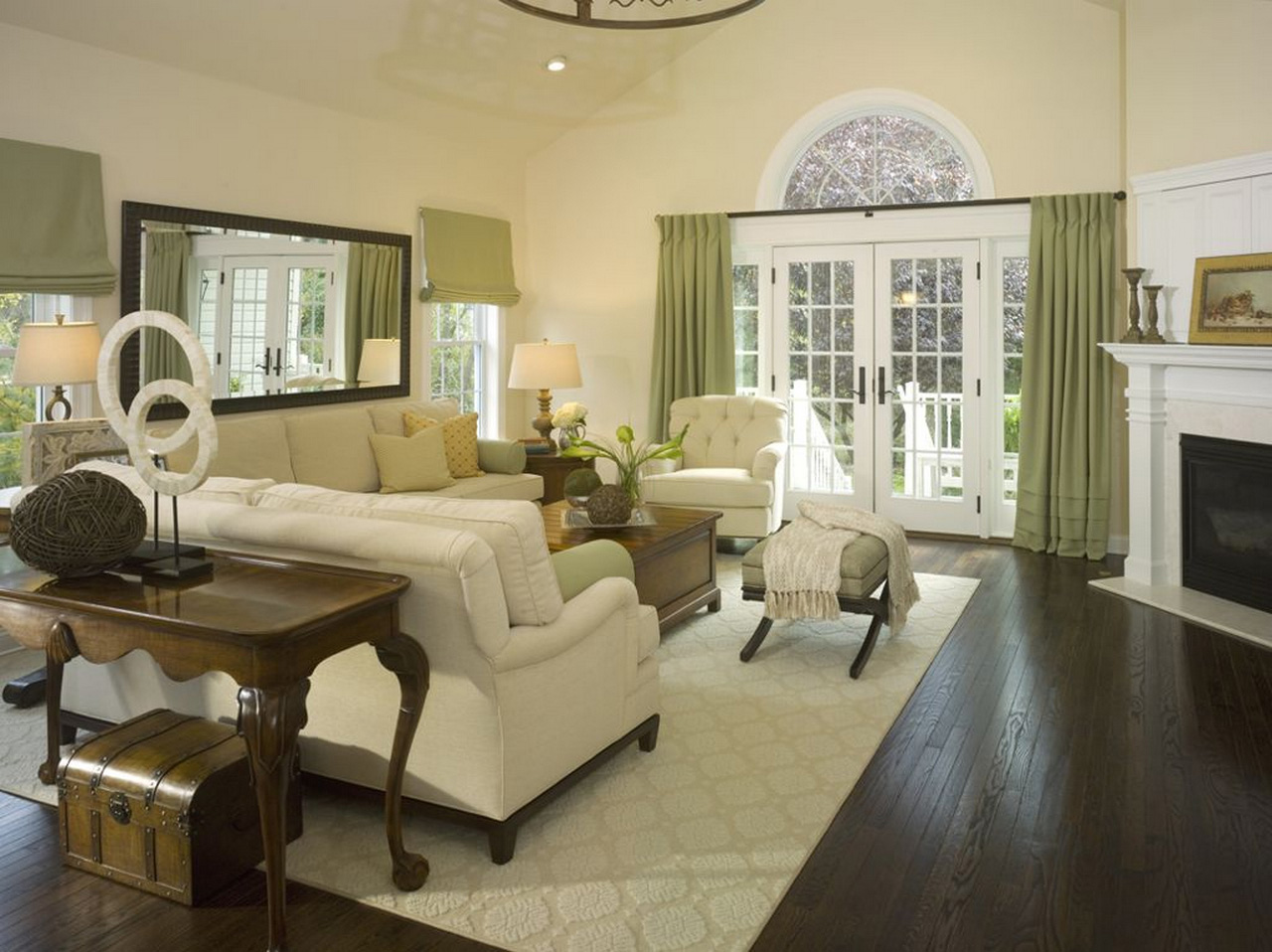 family room ideas-Spacious-family-room-design-using-white-sofa-and-green-window-curtain-also-classic-behind-sofa-table